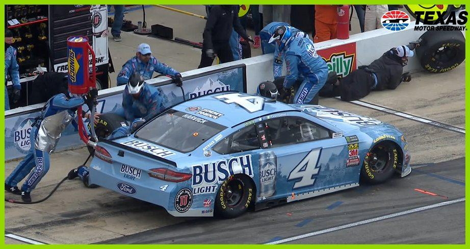 Harvick's crew member falls over pit wall