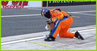 Pit crews fight Mother Nature in Dover
