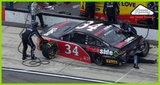 McDowell spins on pit road, stops backward