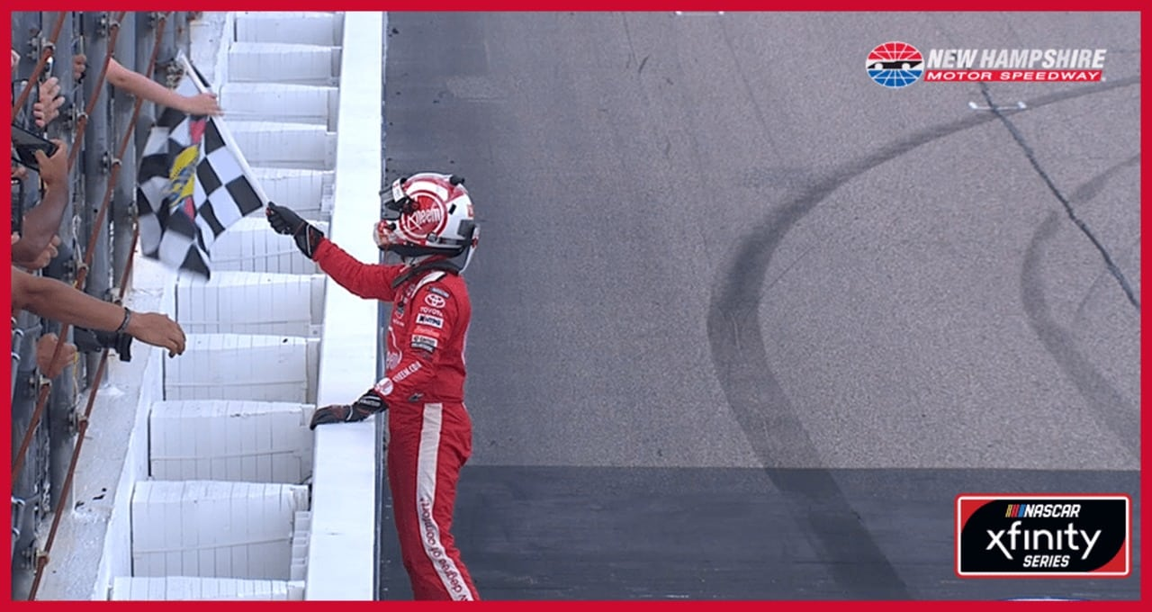 Bell gives checkered flag to young fan