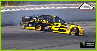 Brad Keselowski backs his No. 2 into wall after blown tire