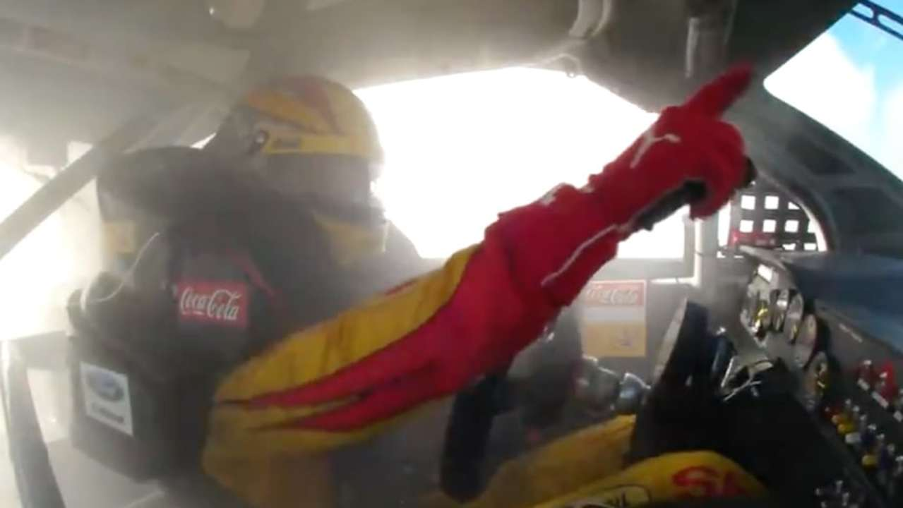 Winning hand: Logano celebrates at The Glen in 2015