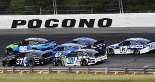 LONG POND, PENNSYLVANIA - JUNE 27: Daniel Suarez, driver of the #96 CommScope Toyota, and Ryan Preece, driver of the #37 P&G Chevrolet, lead the field during the NASCAR Cup Series Pocono Organics 325 in partnership with Rodale Institute at Pocono Raceway on June 27, 2020 in Long Pond, Pennsylvania. (Photo by Jared C. Tilton/Getty Images) | Getty Images